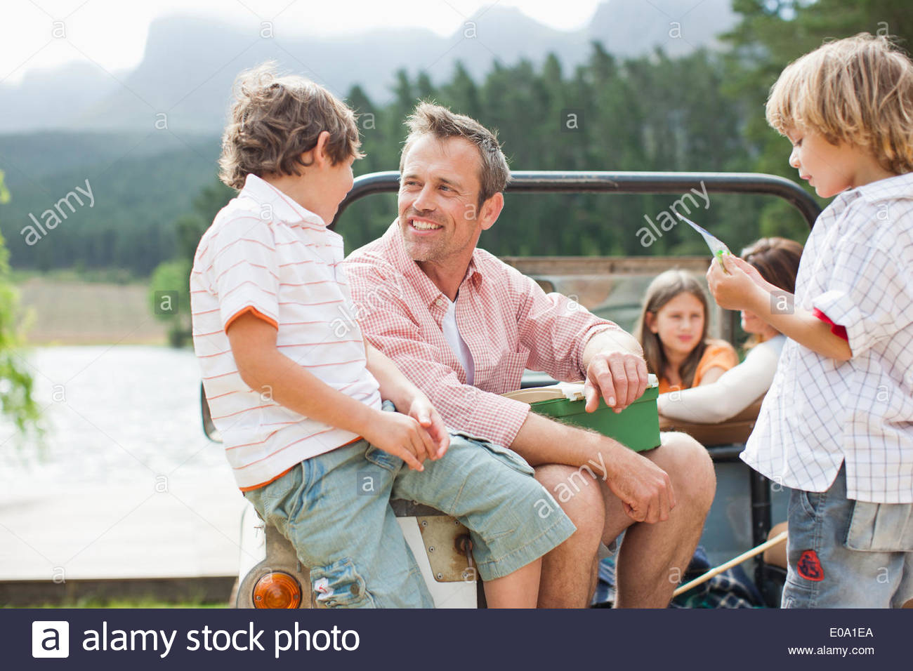 Family sitting in vehicle - Stock Image