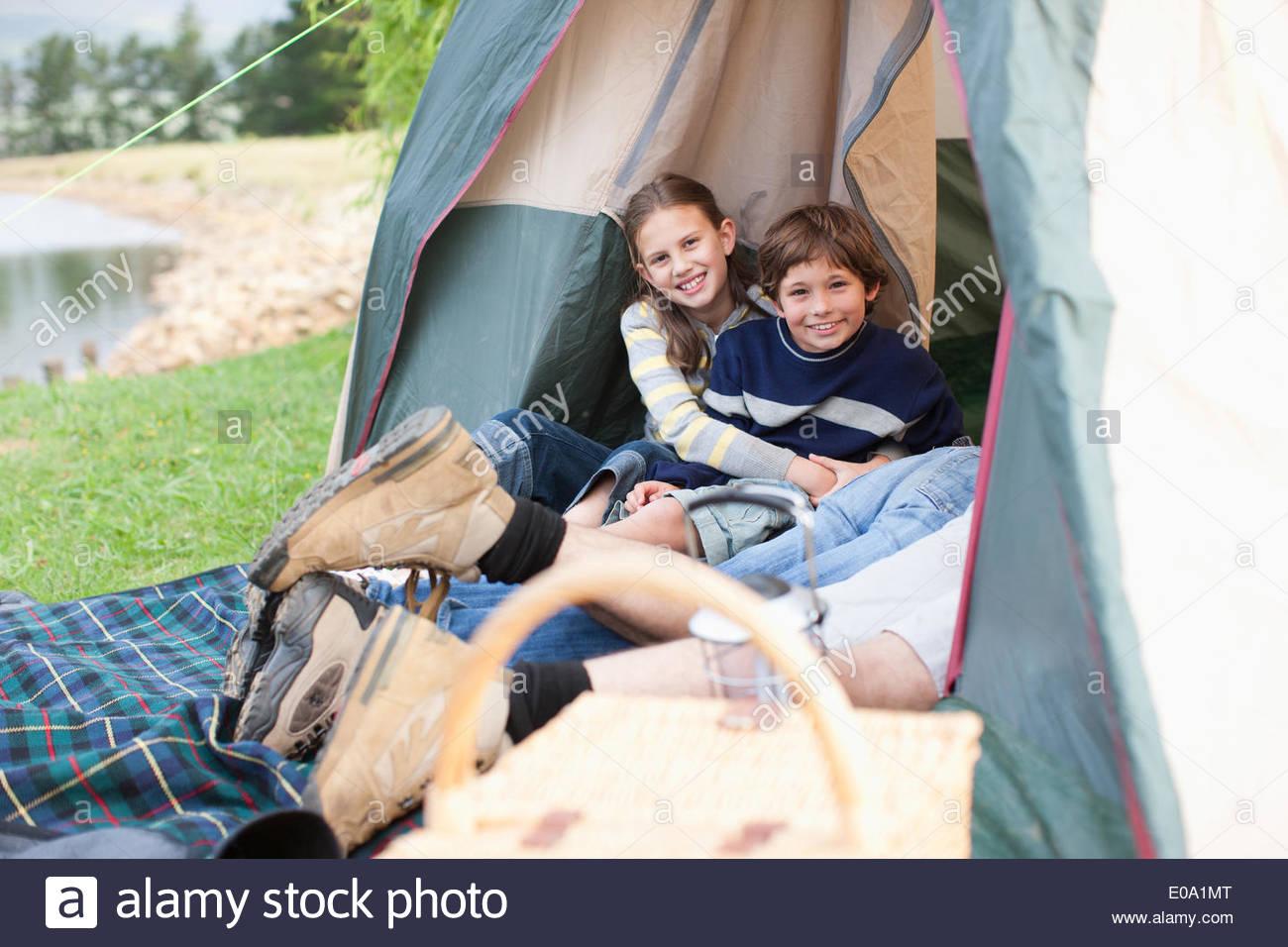 Family camping near lake - Stock Image