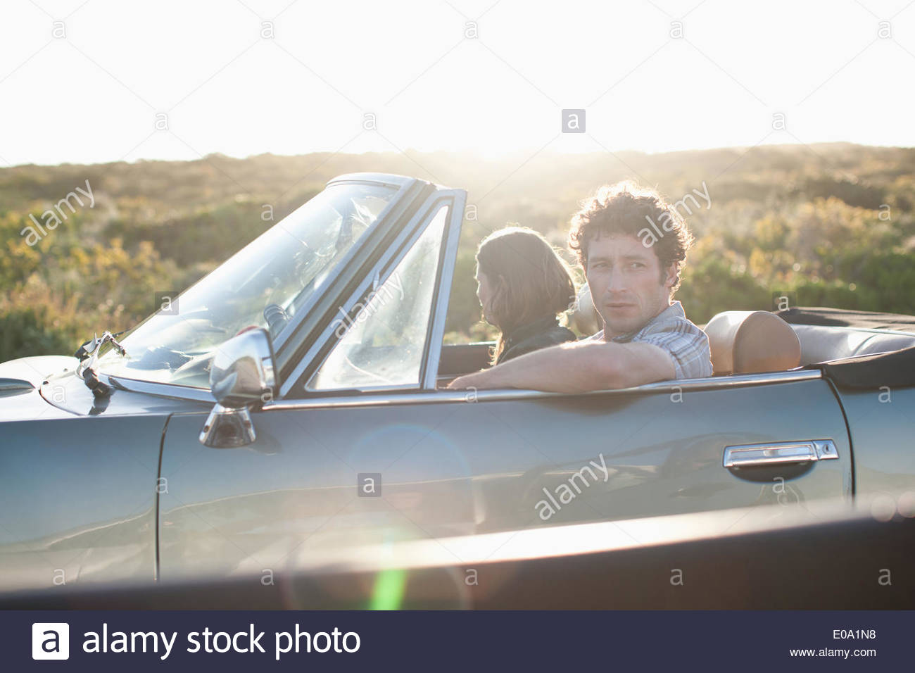 Couple in convertible car - Stock Image
