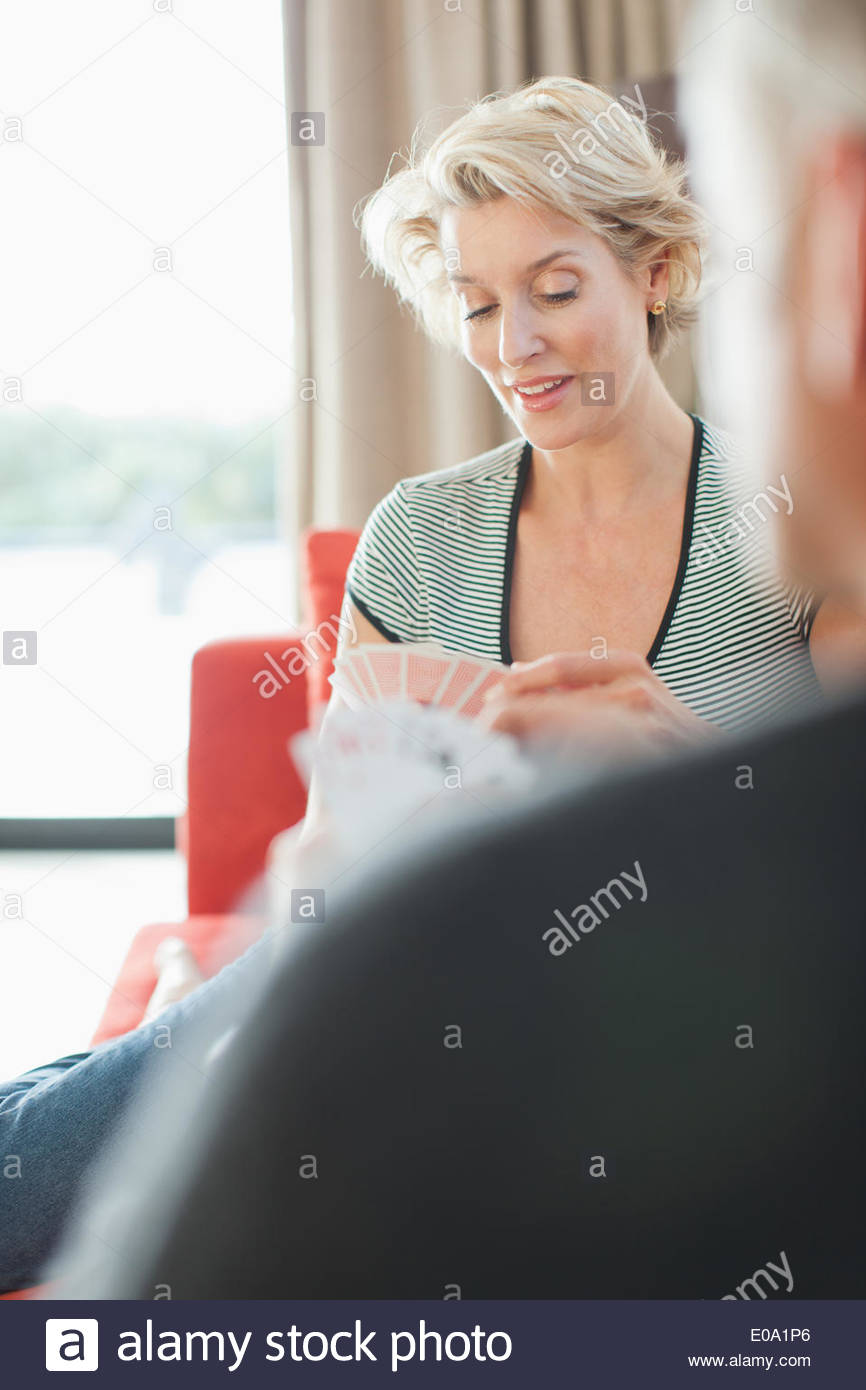 Mature couple playing cards - Stock Image