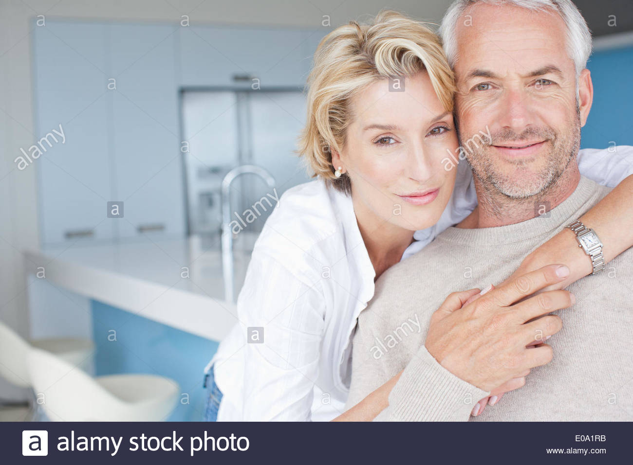 Mature couple hugging - Stock Image