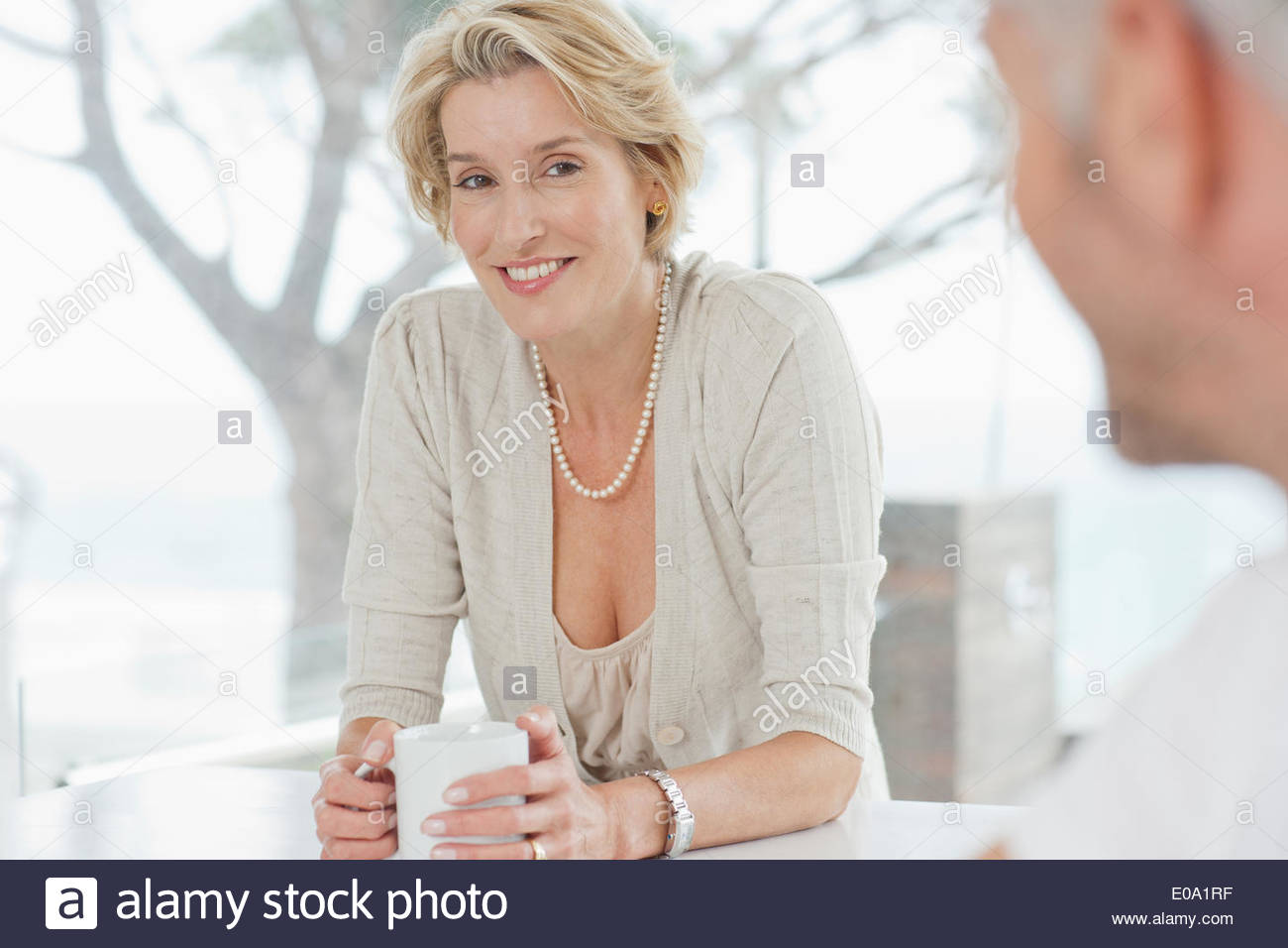 Mature couple drinking coffee together - Stock Image