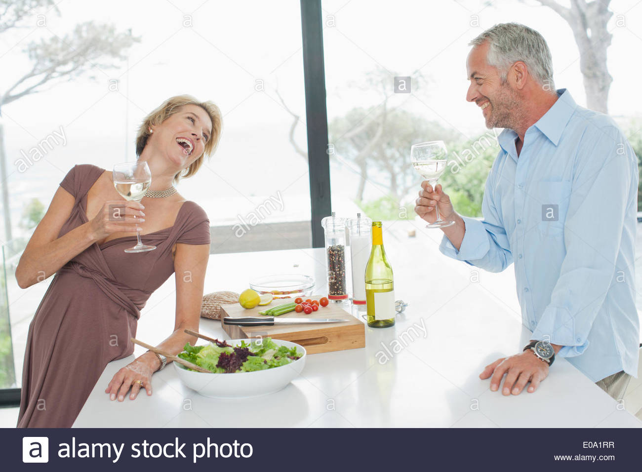 Mature couple drinking white wine - Stock Image