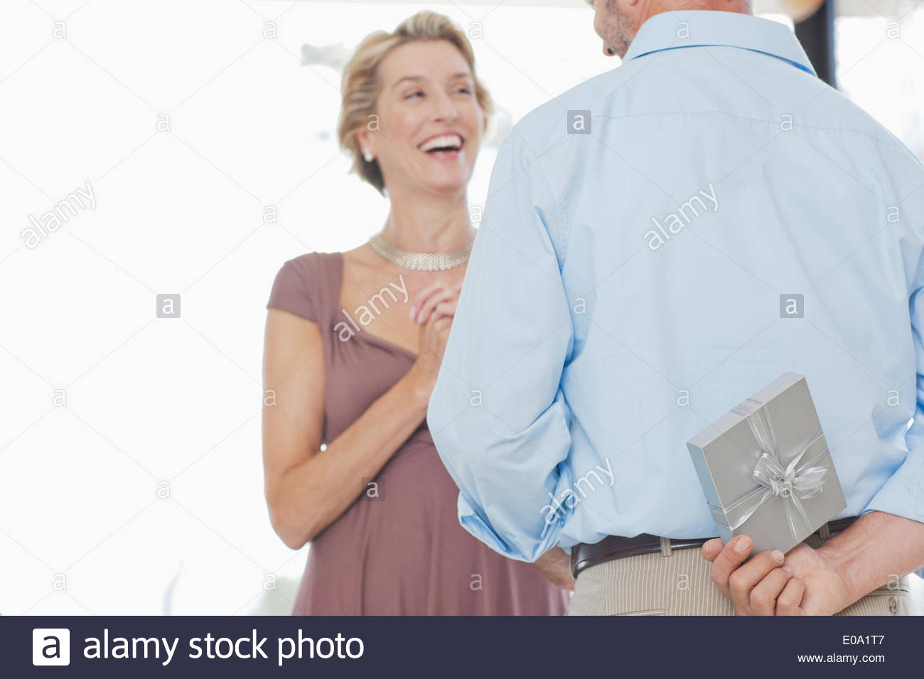 Man giving wife anniversary gift - Stock Image