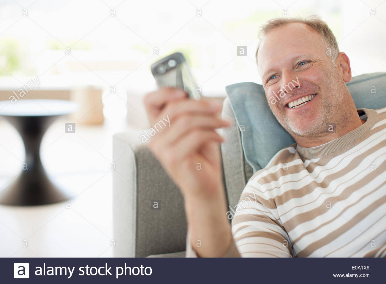 Man text messaging on cell phone Stock Photo