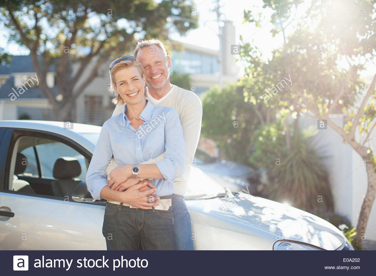 Mature couple hugging outdoors - Stock Image