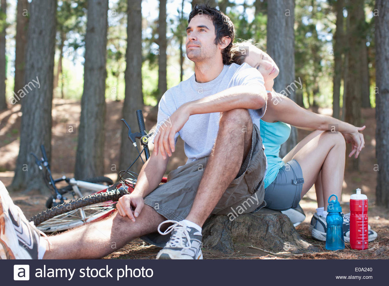 bicycle riders relaxing in remote area - Stock Image