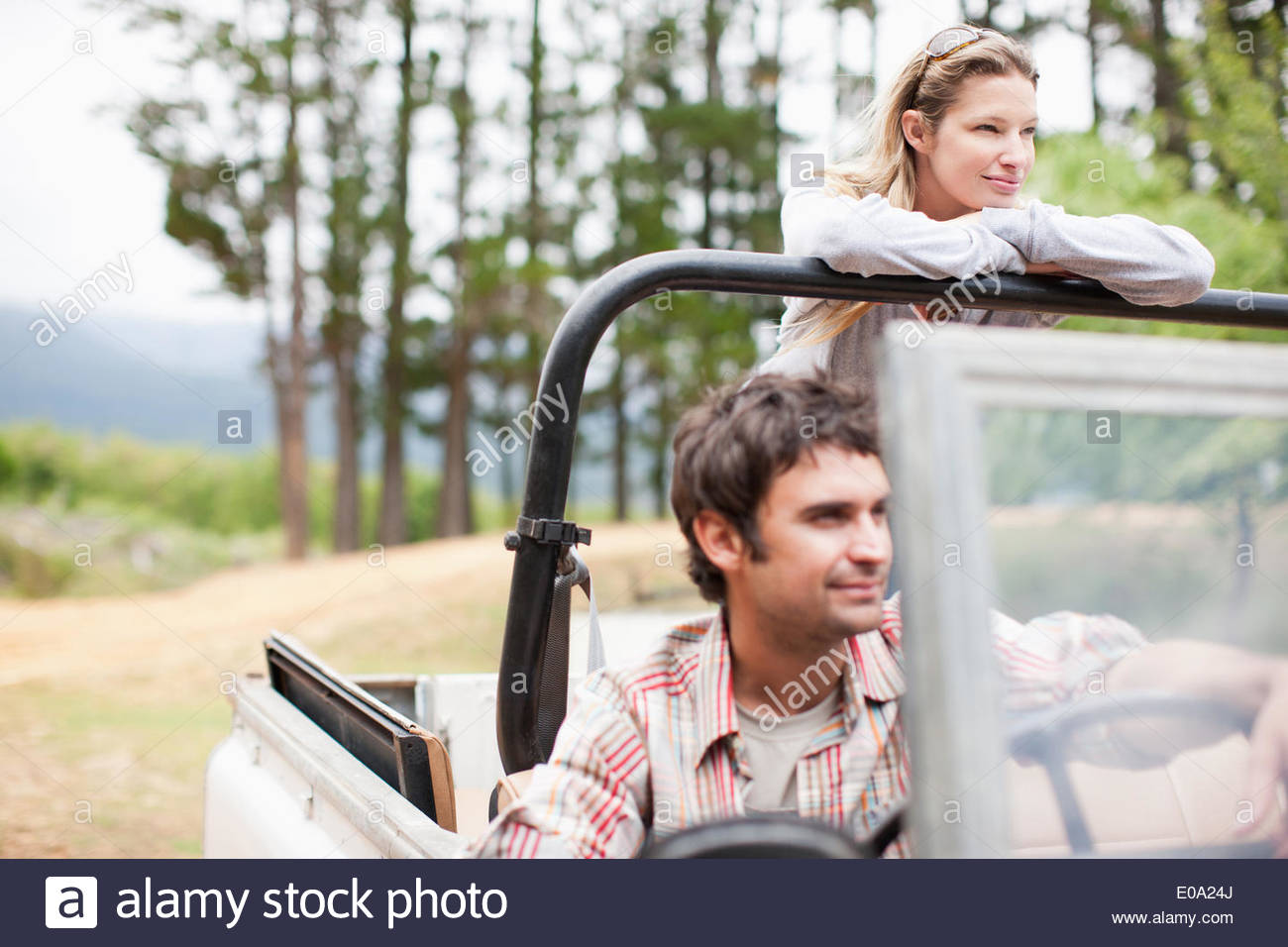 Couple riding in vehicle together - Stock Image