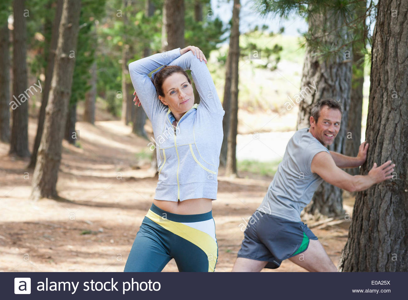 Woman stretching before run in forest Stock Photo