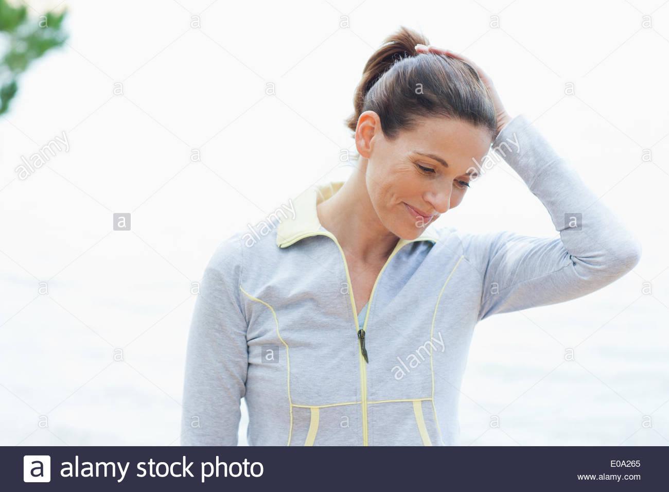 Woman in sportswear smiling - Stock Image