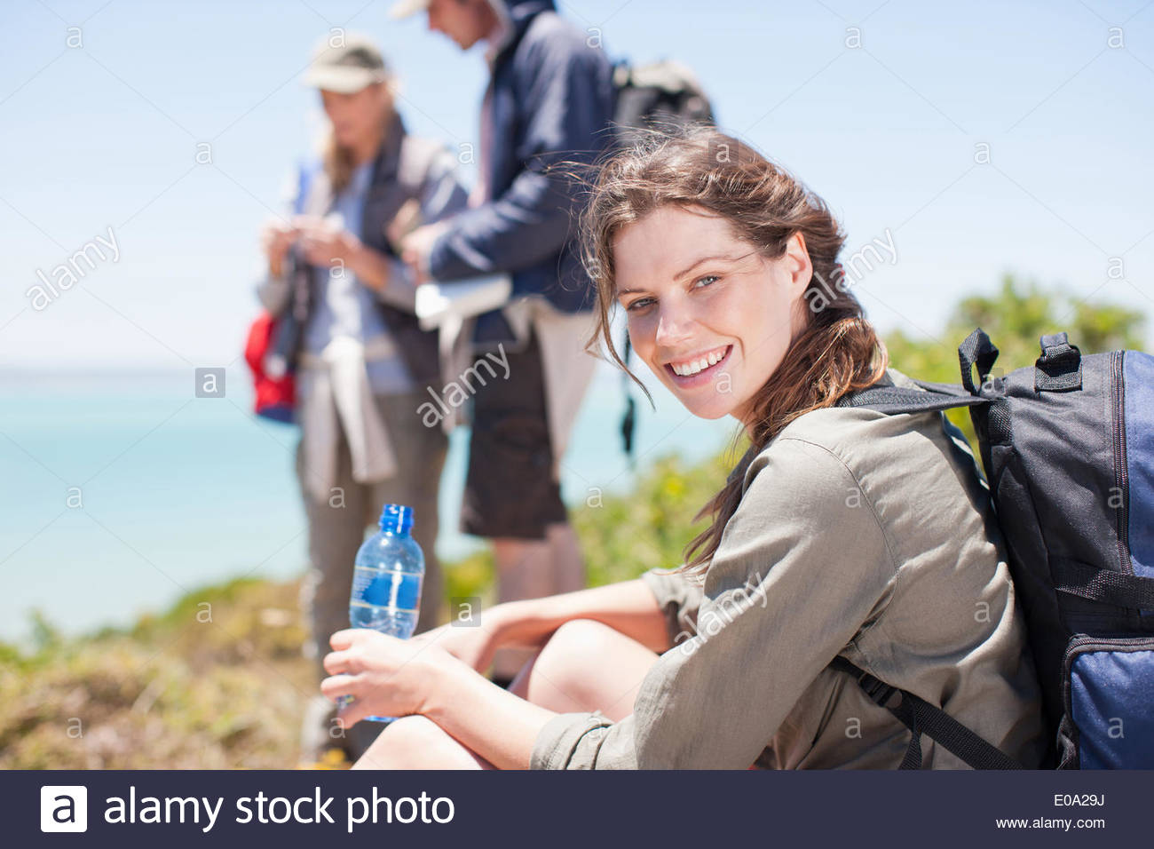Woman hiker drinking water - Stock Image