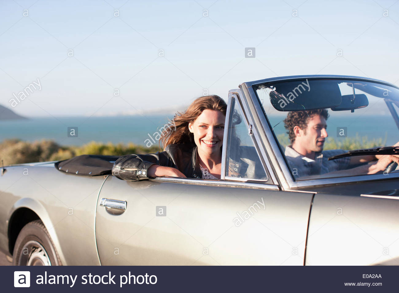 Couple riding in car  together - Stock Image