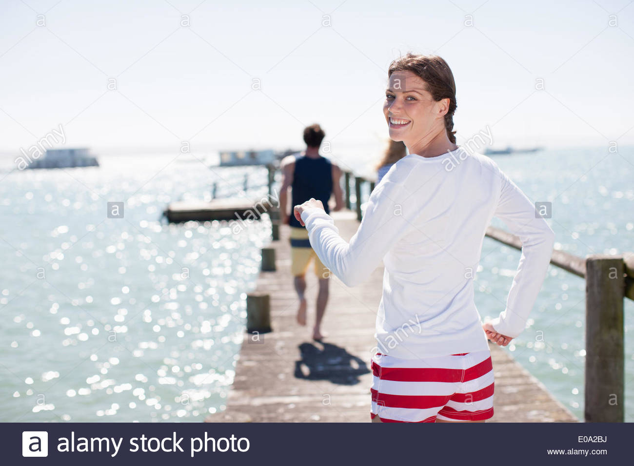 Friends on pier - Stock Image
