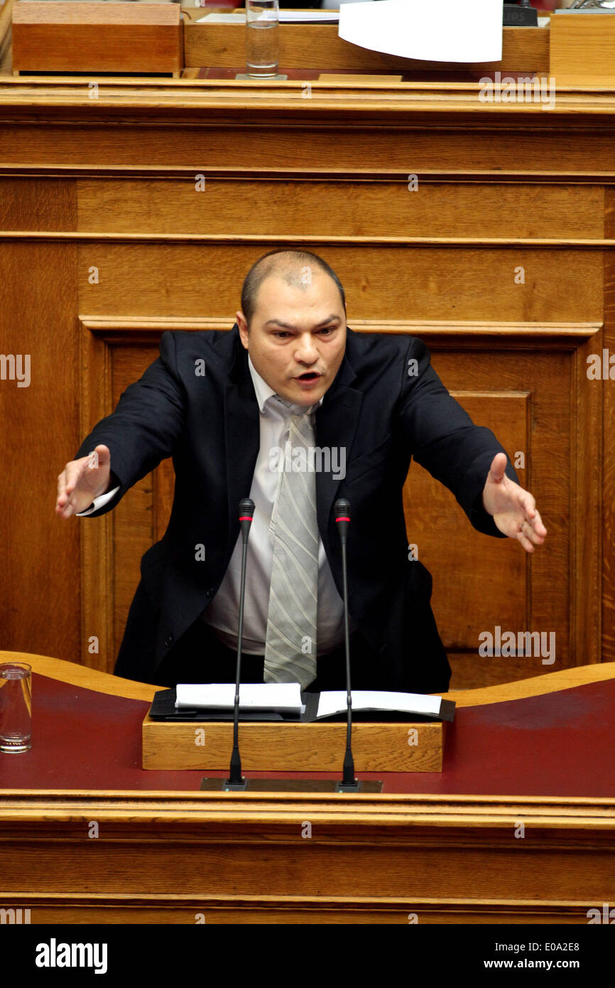 Athens, Giorgos Germenis speaks during a parliament session in Athens. 7th May, 2014. Lawmaker of the ultra nationalist Golden Dawn party, Giorgos Germenis speaks during a parliament session in Athens, Greece on May 7, 2014. Parliament is debating whether to strip the four Golden Dawn lawmakers of their prosecution immunity, so they can answer charges of illegal weapons possession and participation in a criminal organisation. © Marios Lolos/Xinhua/Alamy Live News - Stock Image