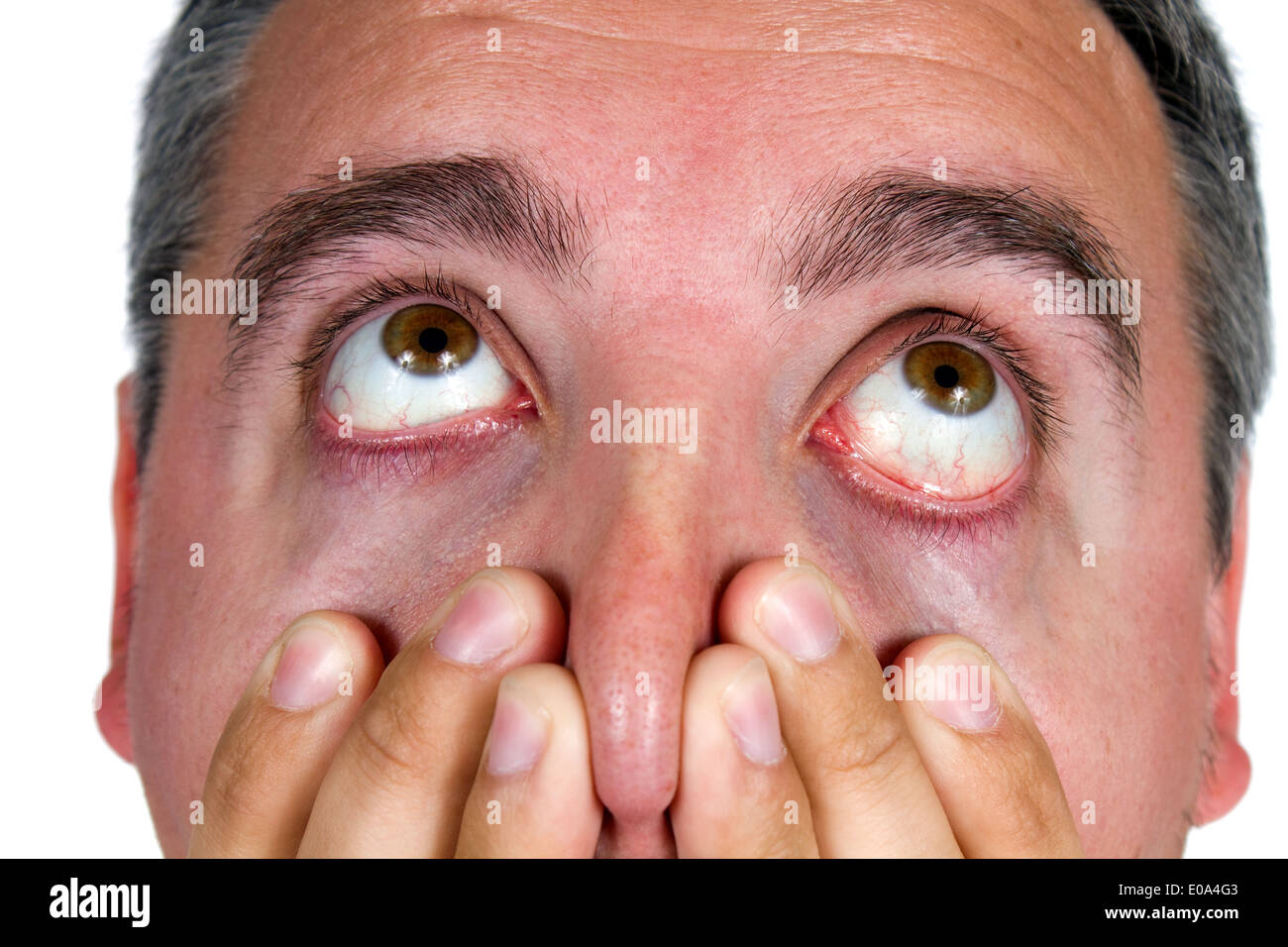 Eyeballs of man as he looks up in surprise and shock. - Stock Image