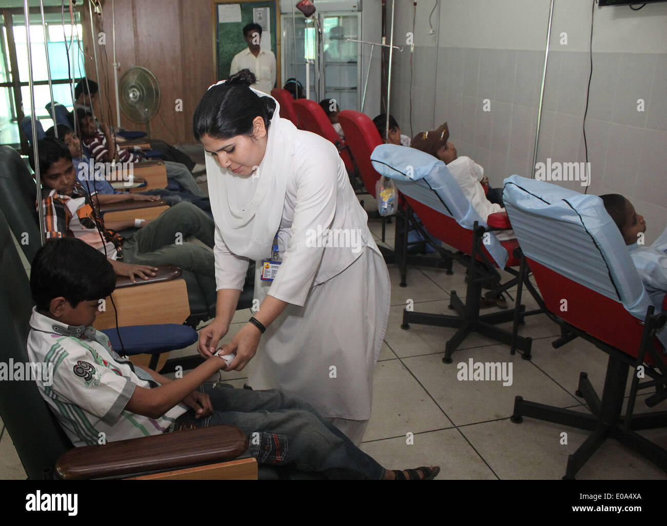 LAHORE, PAKISTAN-MAY 7: Pakistani Thalassemia affected children patients being treated by blood transfusion at Fatmeed Stock Photo