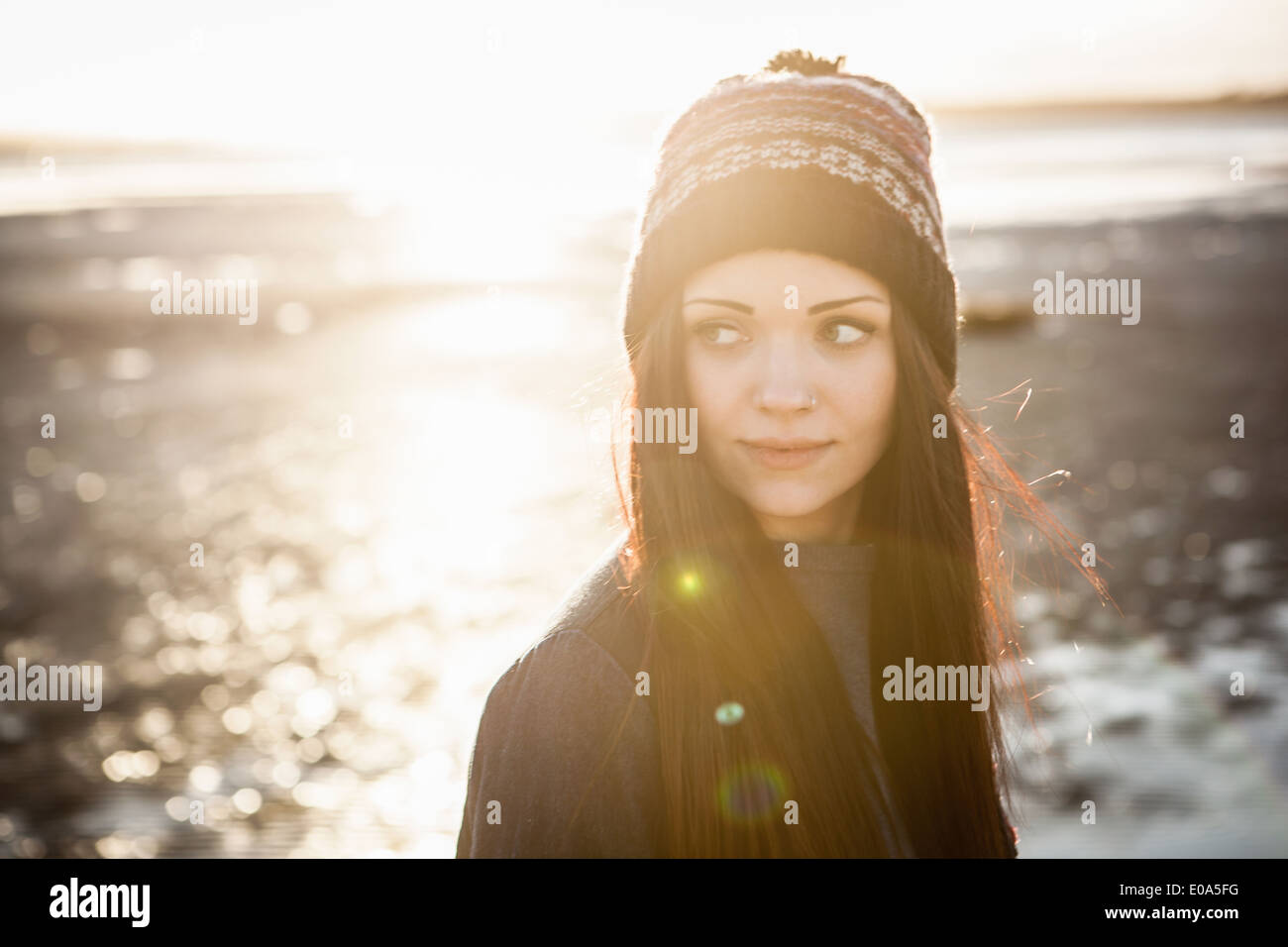 Portrait of young woman on the beach - Stock Image