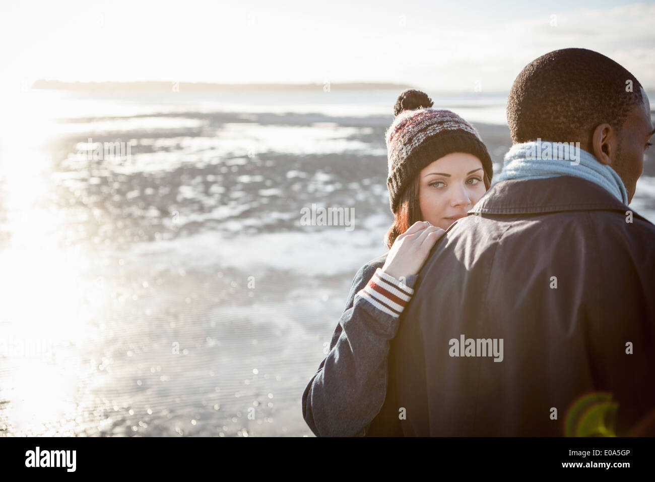 Romantic young couple walking on the beach Stock Photo