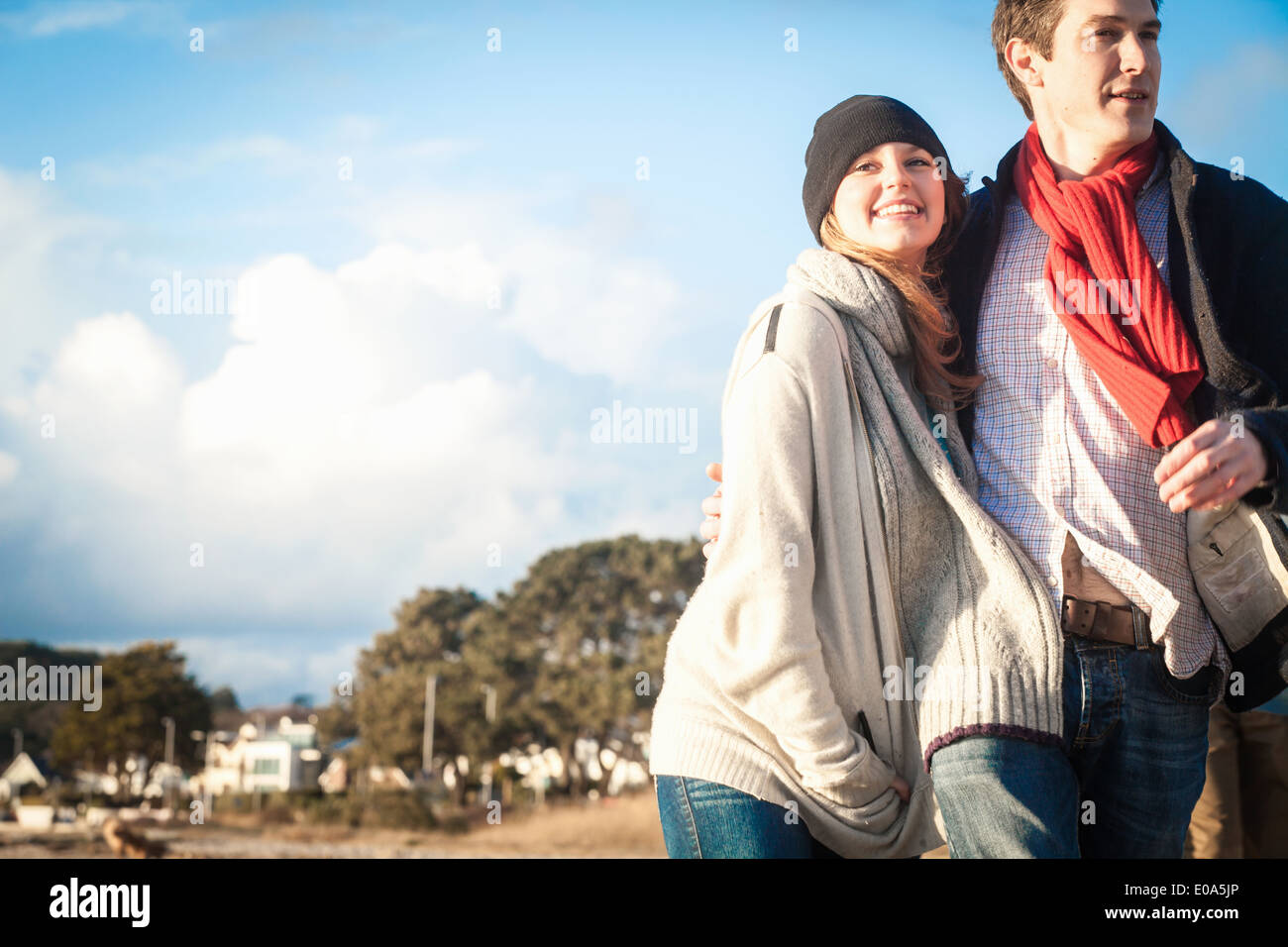 Romantic couple out strolling at the coast - Stock Image