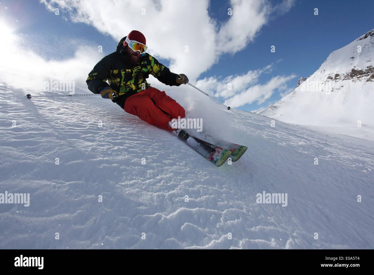 Mid adult man skiing at speed downhill, Mayrhofen, Tyrol, Austria Stock Photo