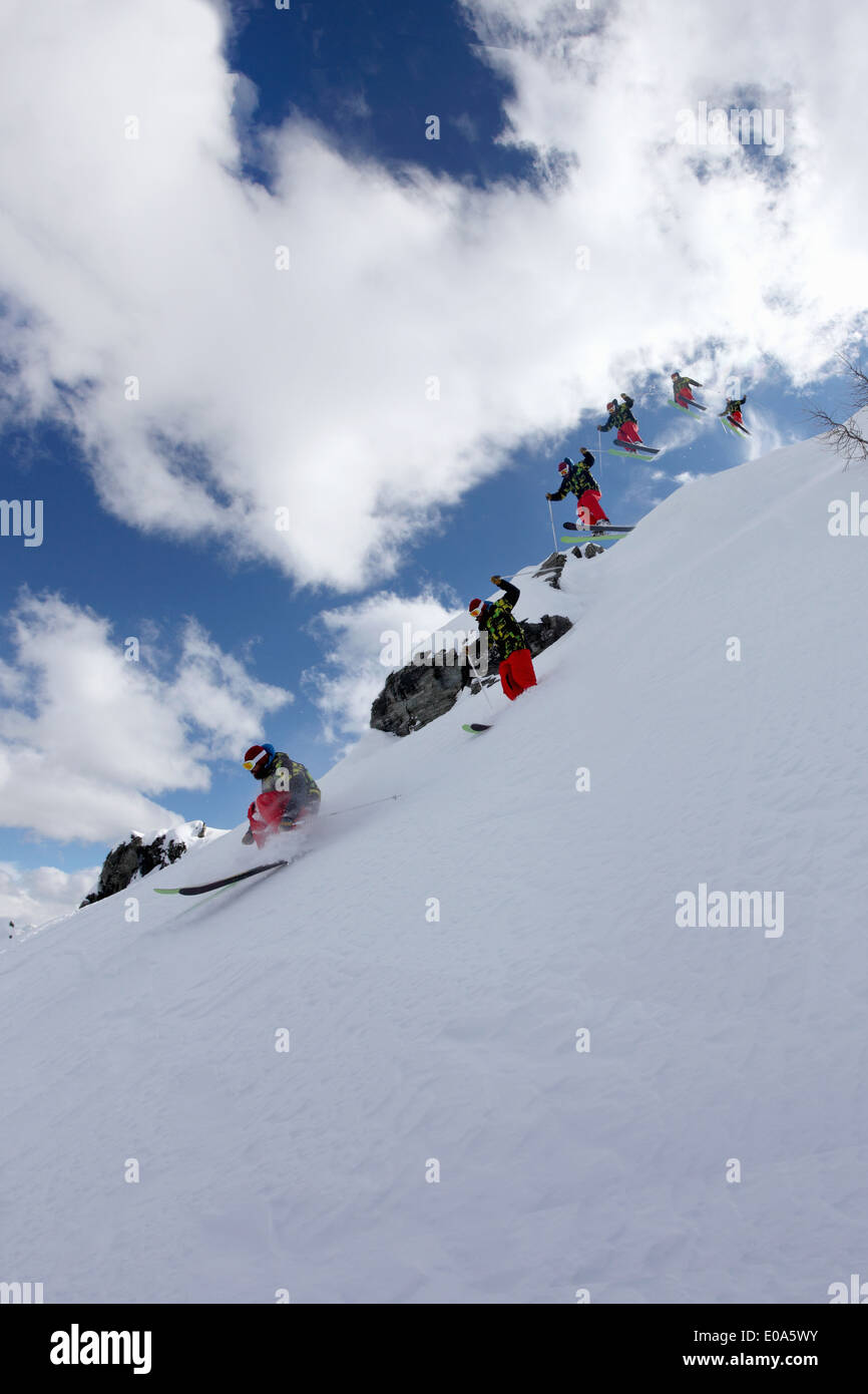 Multi exposure of mid adult male skiing down mountain, Mayrhofen, Tyrol, Austria - Stock Image