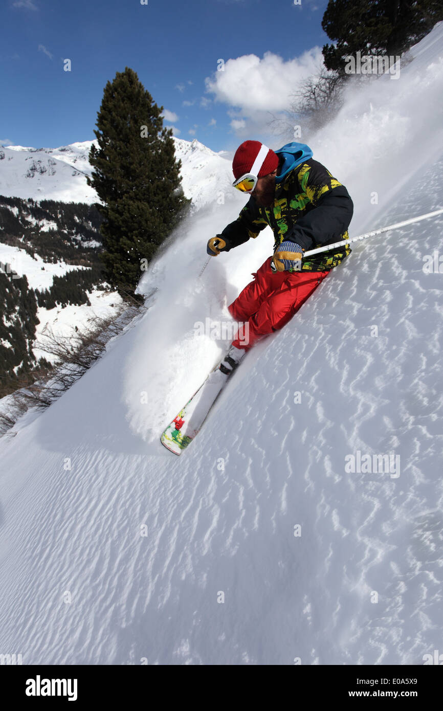 Mid adult man skiing down steep mountain, Mayrhofen, Tyrol, Austria - Stock Image