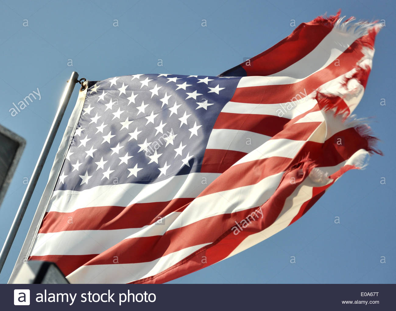 The Stars and Stripes flag fluttering in the breeze - Stock Image