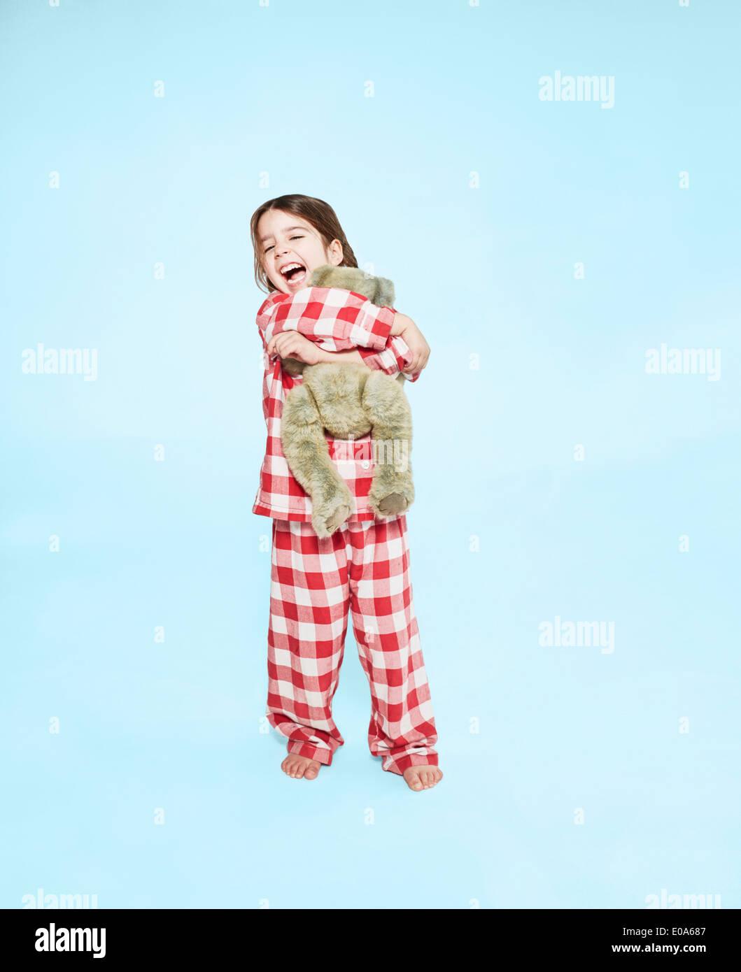 Girl hugging teddy bear - Stock Image