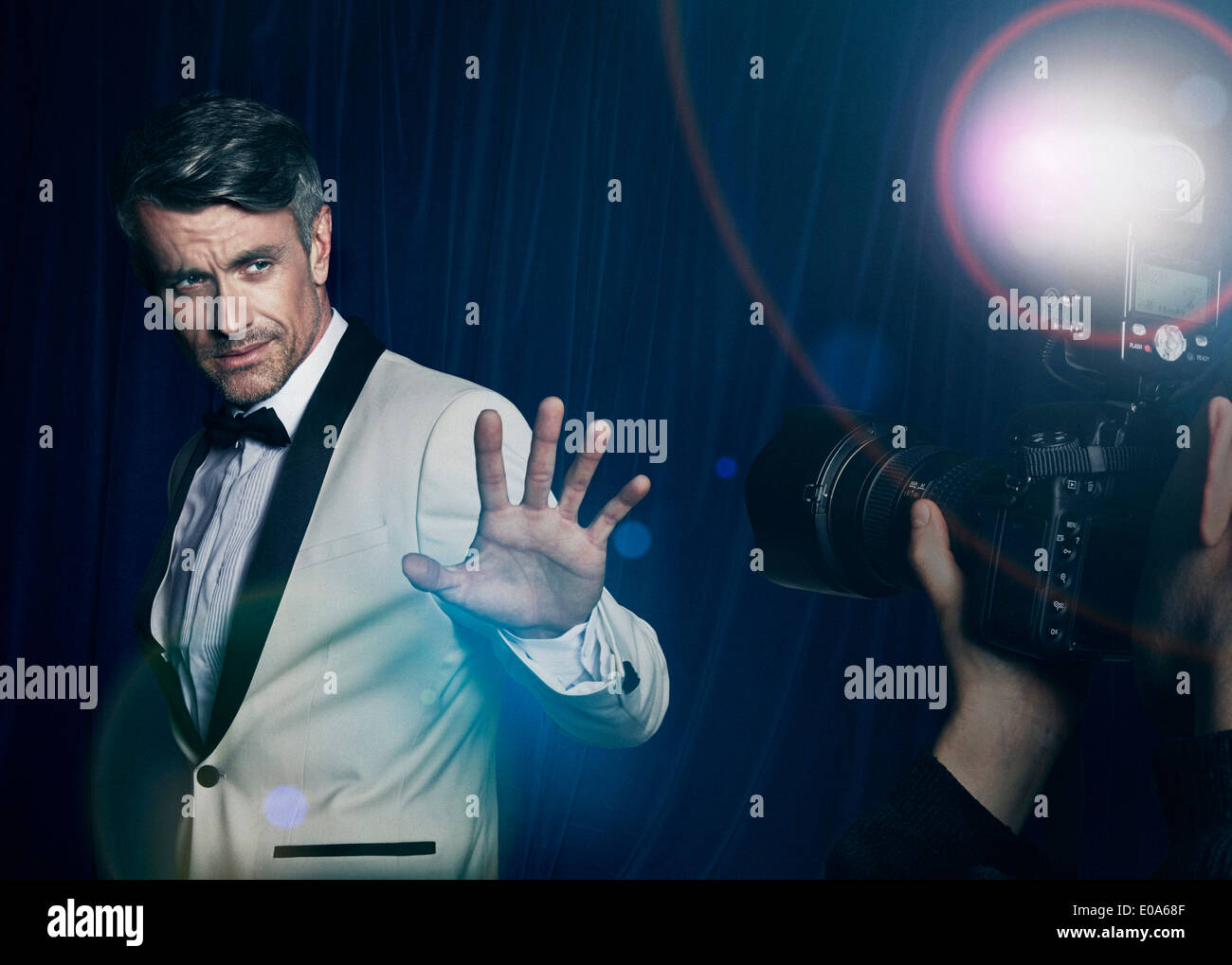 Paparazzi photographing celebrity - Stock Image