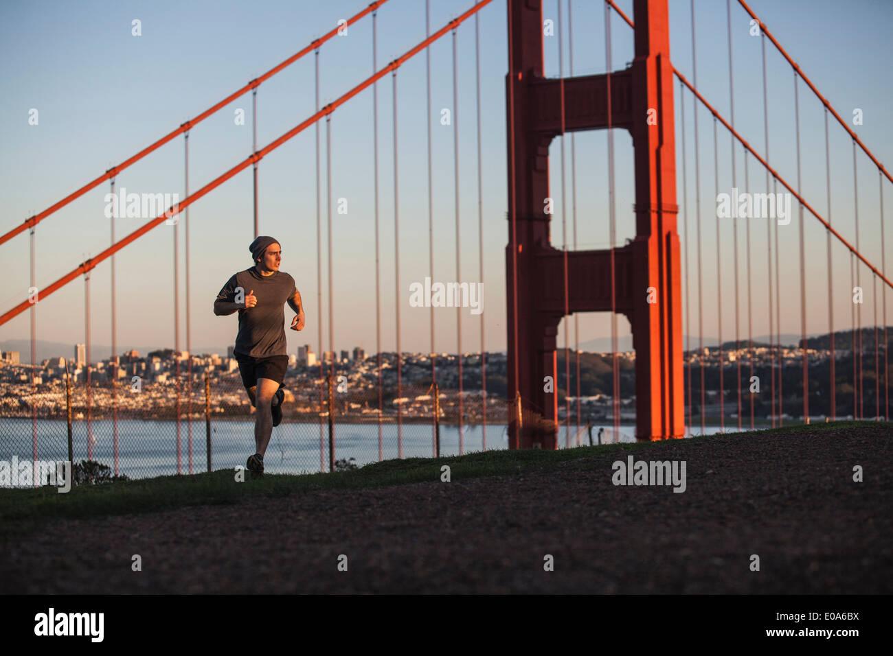 Young man out running near golden gate bridge - Stock Image