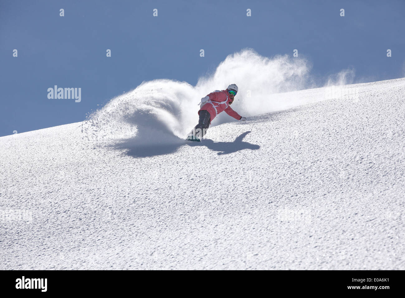 Young woman snowboarding on mountain, Hintertux, Tyrol, Austria - Stock Image