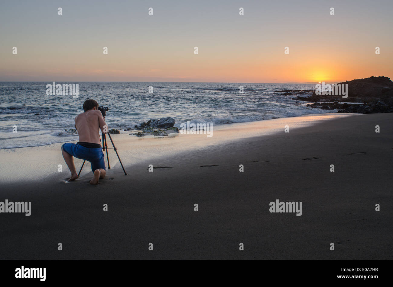 Teenage boy taking photos, Table Rock Beach, Laguna Beach, California, USA - Stock Image