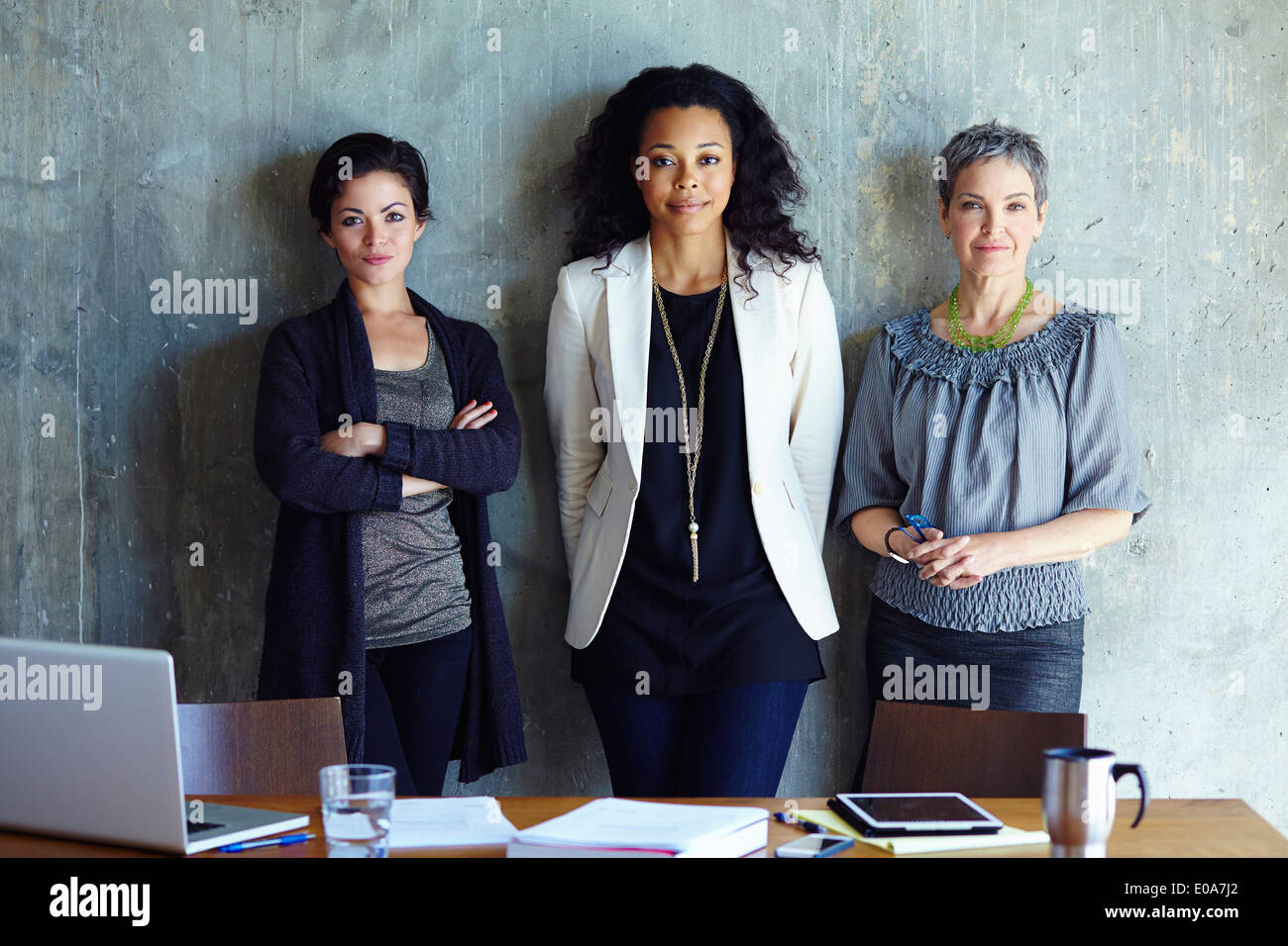 Portrait of three businesswoman in office - Stock Image