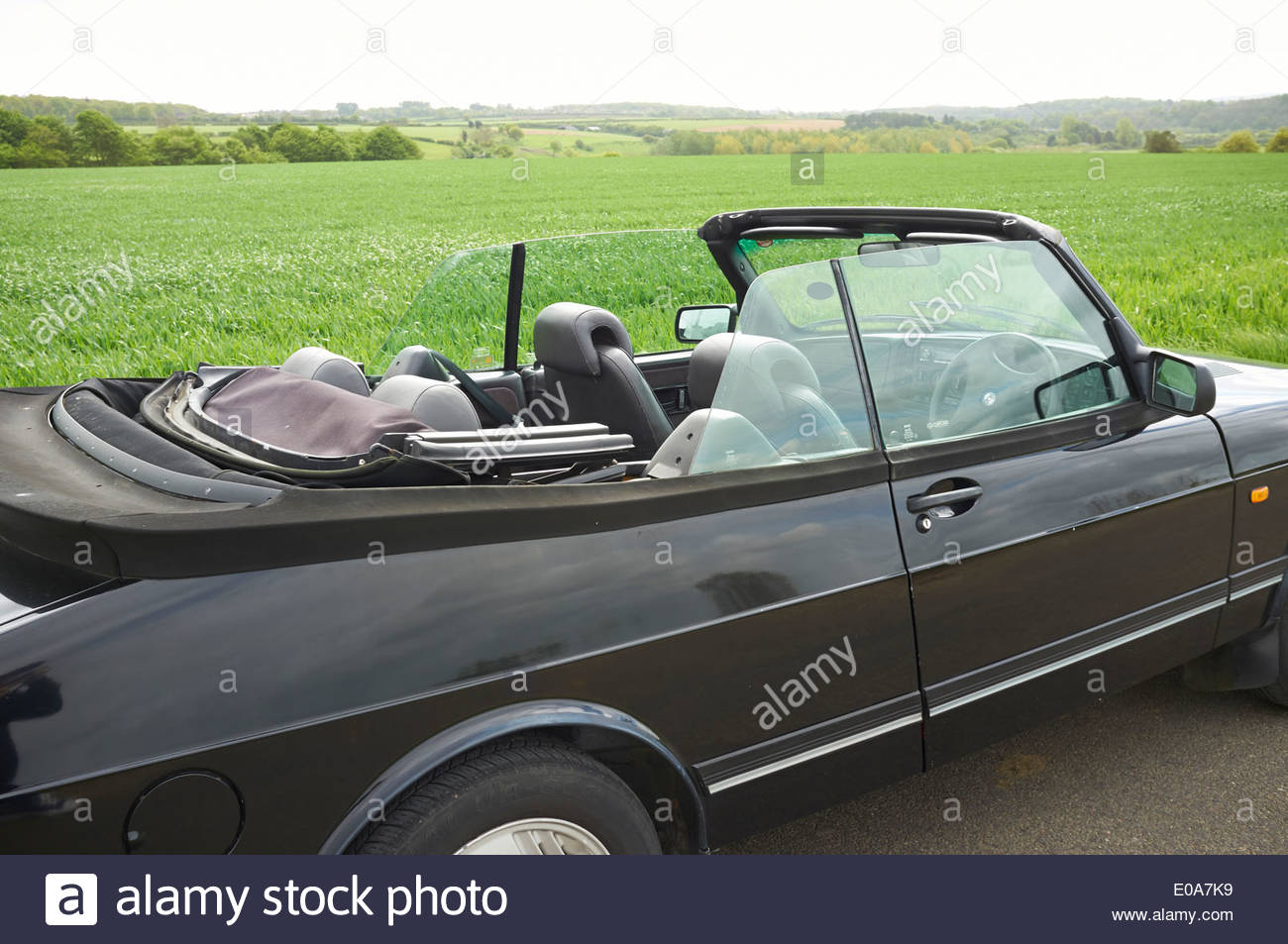 Black Saab 900 Convertible classic car parked in Oxfordshire UK - Stock Image
