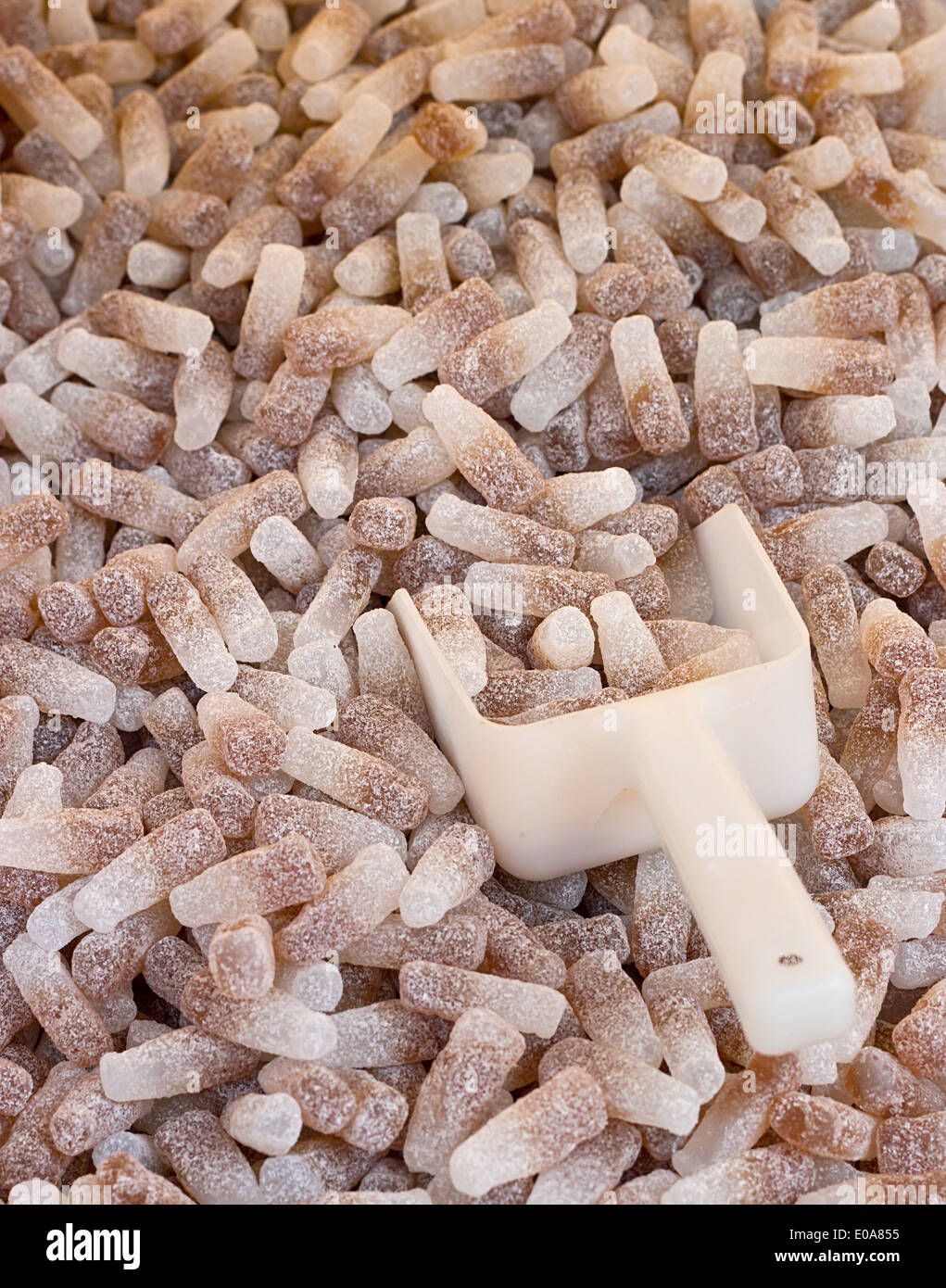Fizzy Cola Bottles a popular retro sweet also known as Gummy candy at a pick and mix self service market. - Stock Image