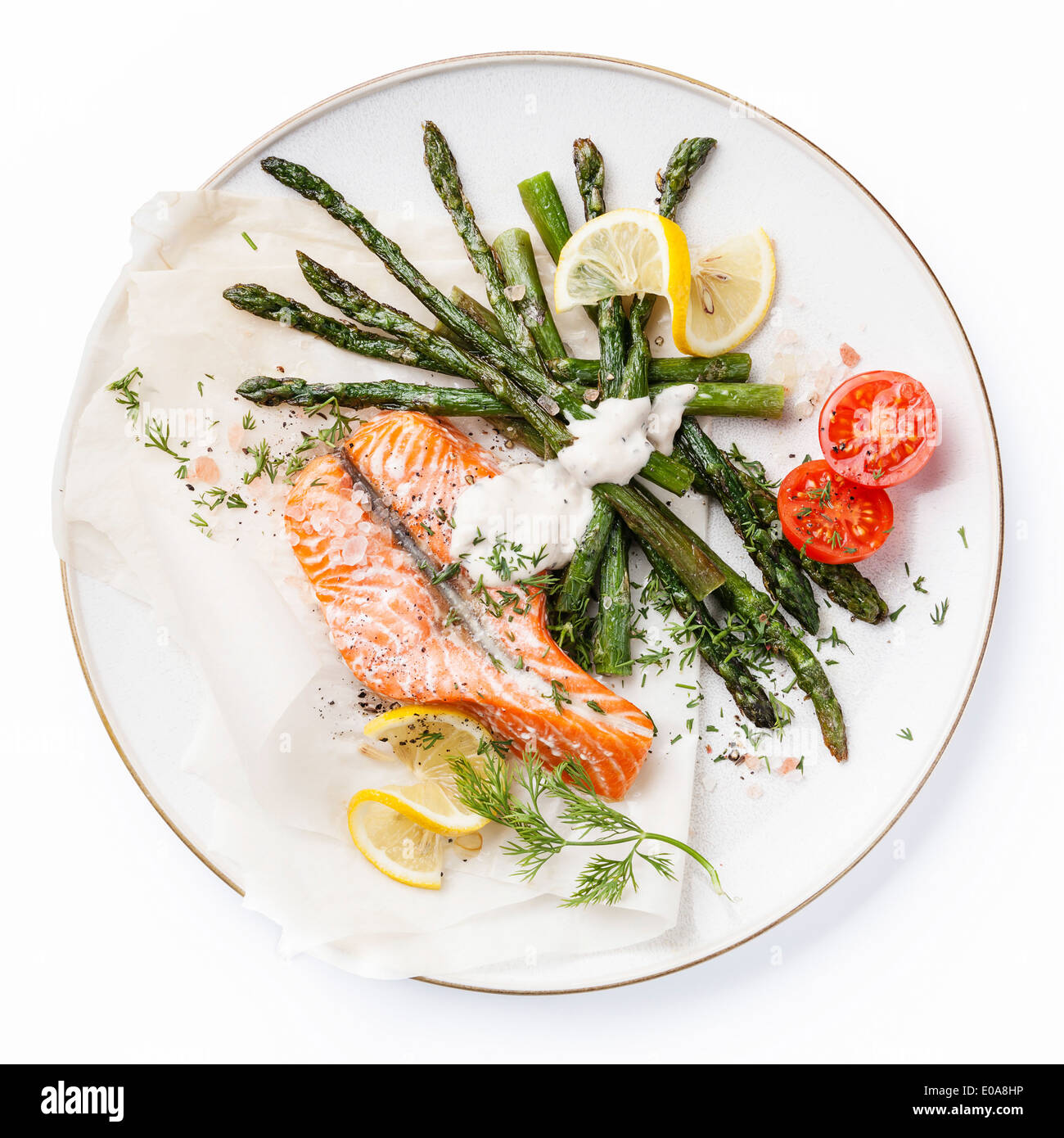 Grilled salmon with asparagus isolated on white background - Stock Image