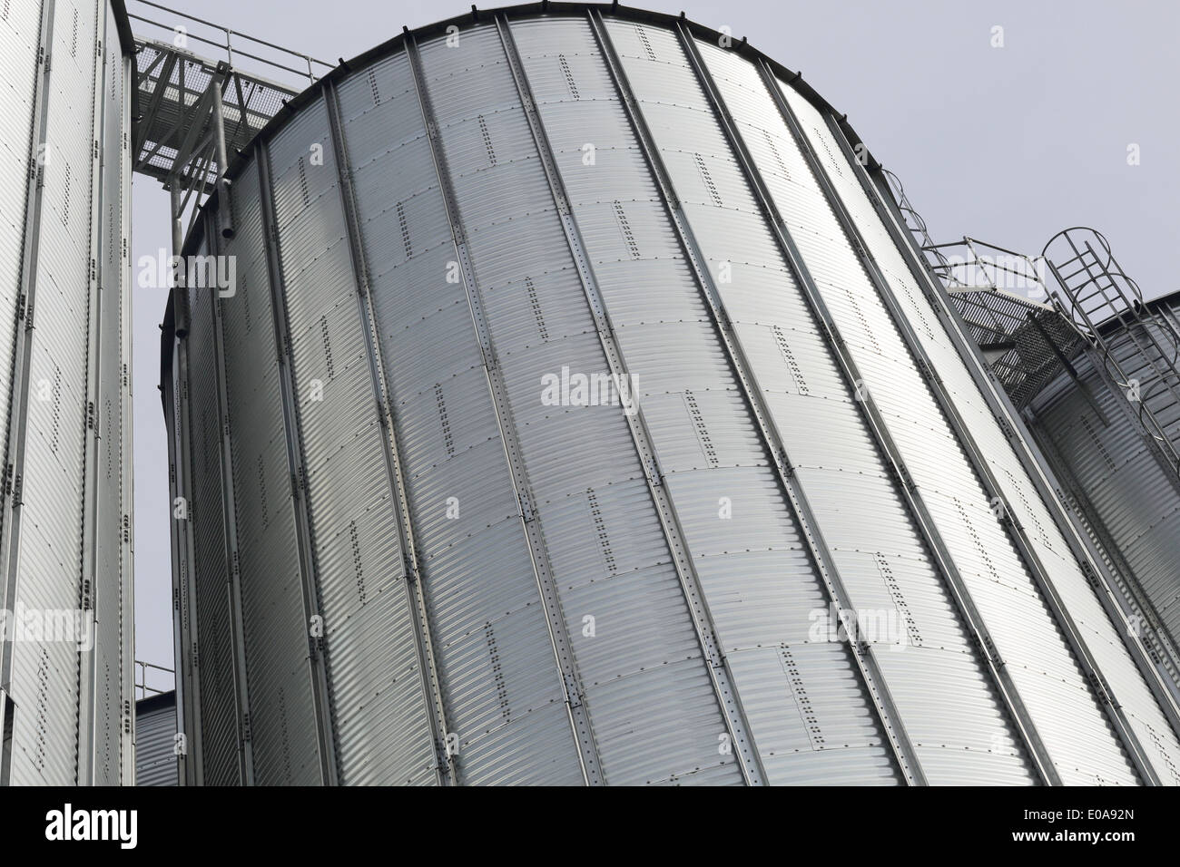 Detail of silver silos in port - Stock Image