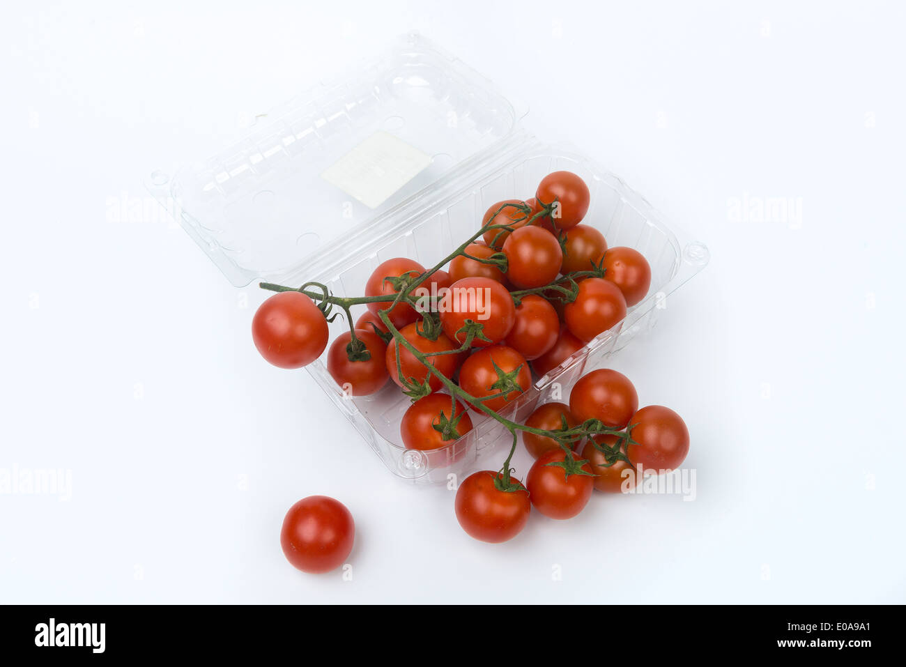 tomatoes in a transparent container - Stock Image