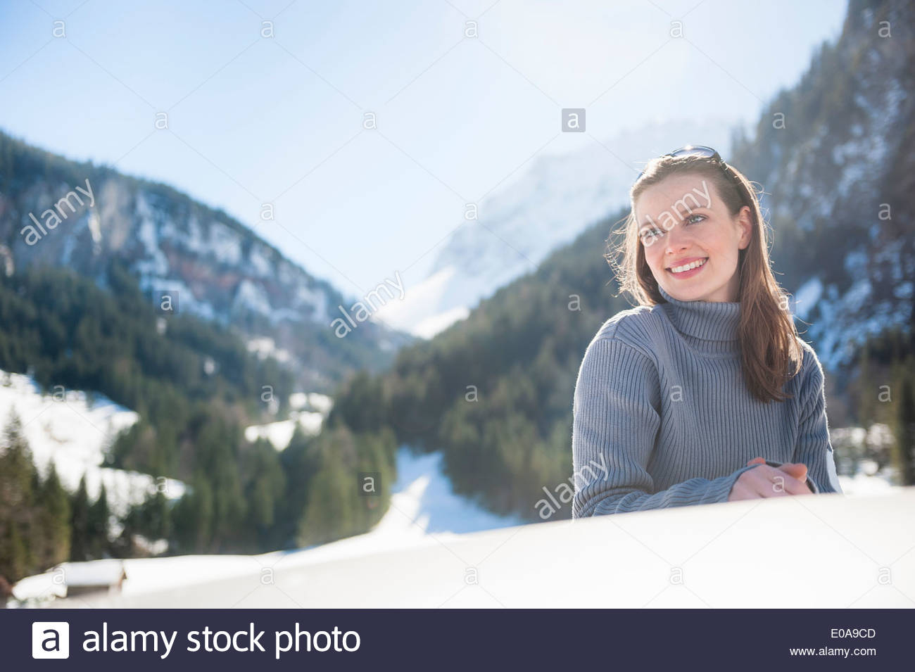 Portrait of young woman on road trip, Bludenz, Austria Stock Photo