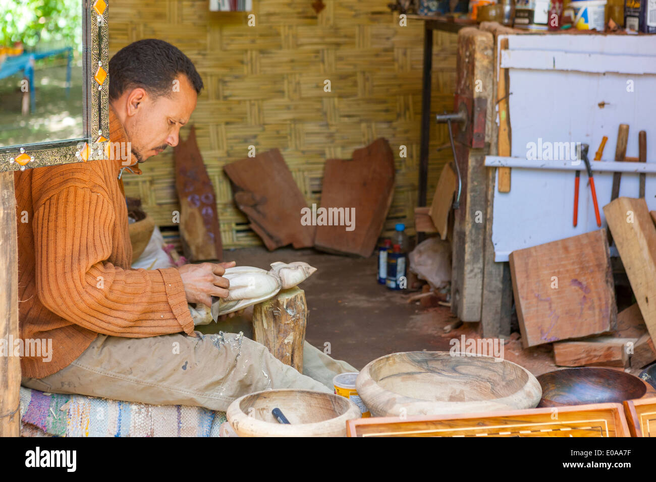 Craftsman making wooden souvenirs at the Ourika Valley, Setti-Fatma near Marrakesh, Morocco. - Stock Image