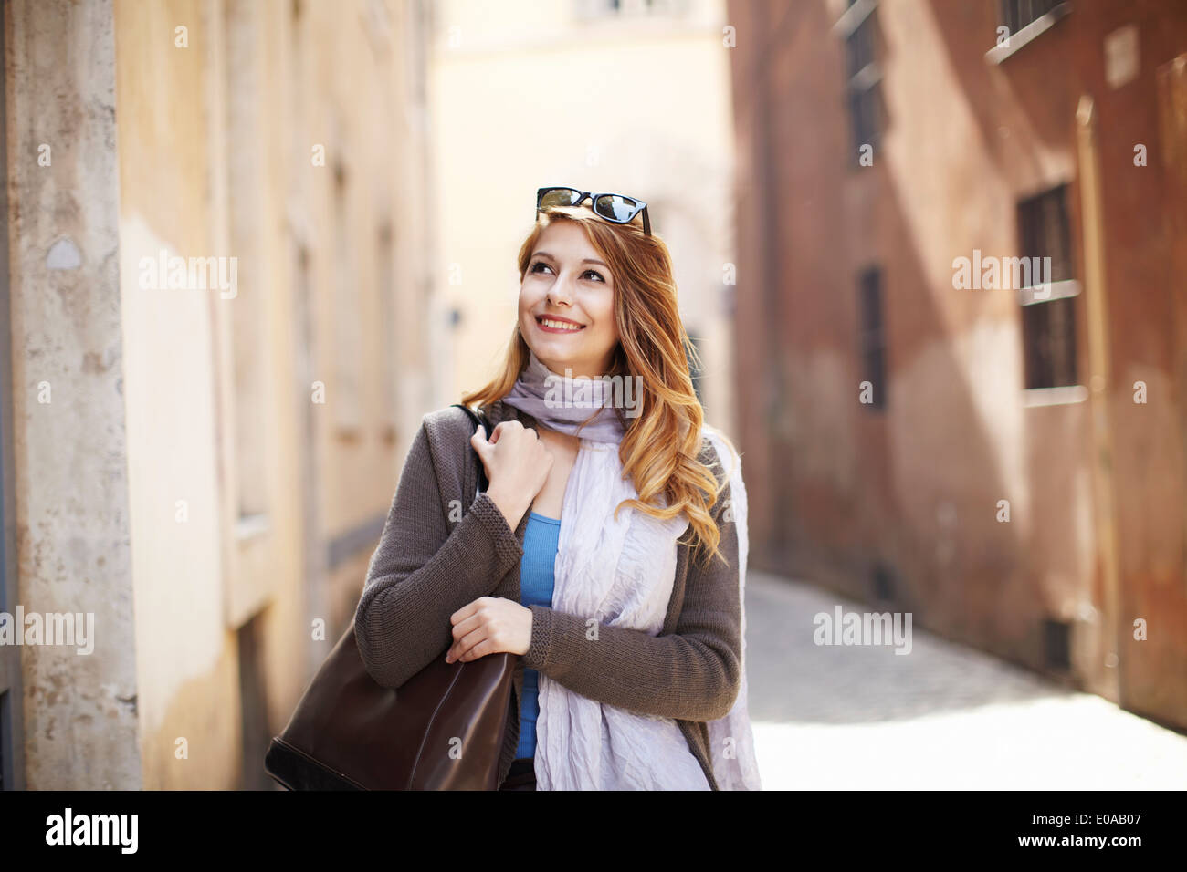 Young sophisticated woman exploring streets, Rome, Italy - Stock Image
