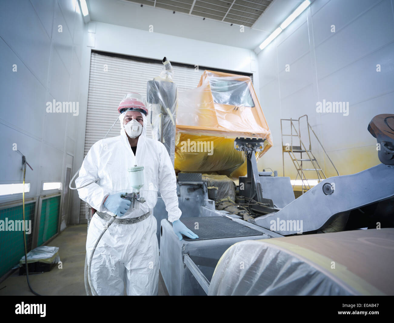Portrait of paint spray technician in truck repair factory - Stock Image