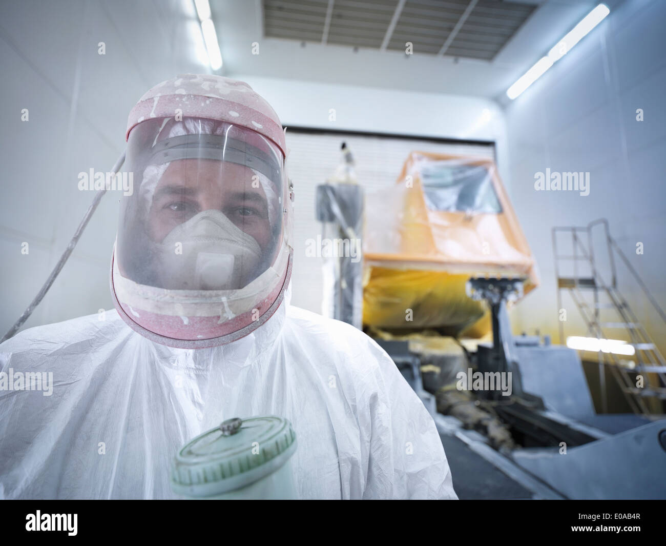 Portrait of paint spray technician in truck repair factory, close up - Stock Image