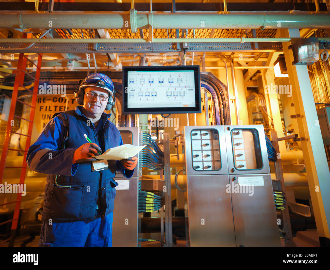 Portrait of engineer with digital display in power station - Stock Image