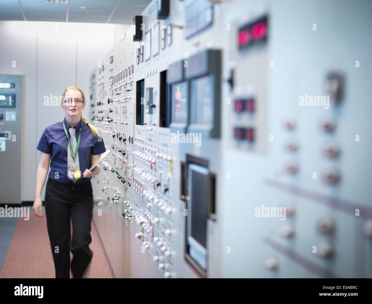Female engineer in nuclear power station control room simulator - Stock Image