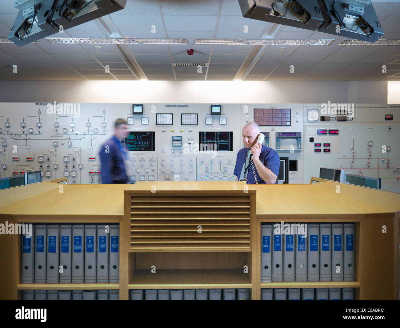 Engineers in nuclear power station control room simulator - Stock Image