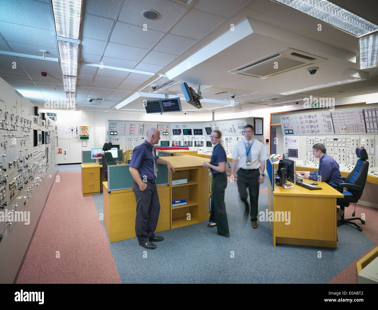 Engineers working in nuclear power station control room simulator - Stock Image