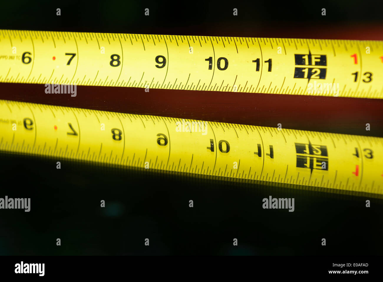 Carpenter's retractable tape measure tool. - Stock Image