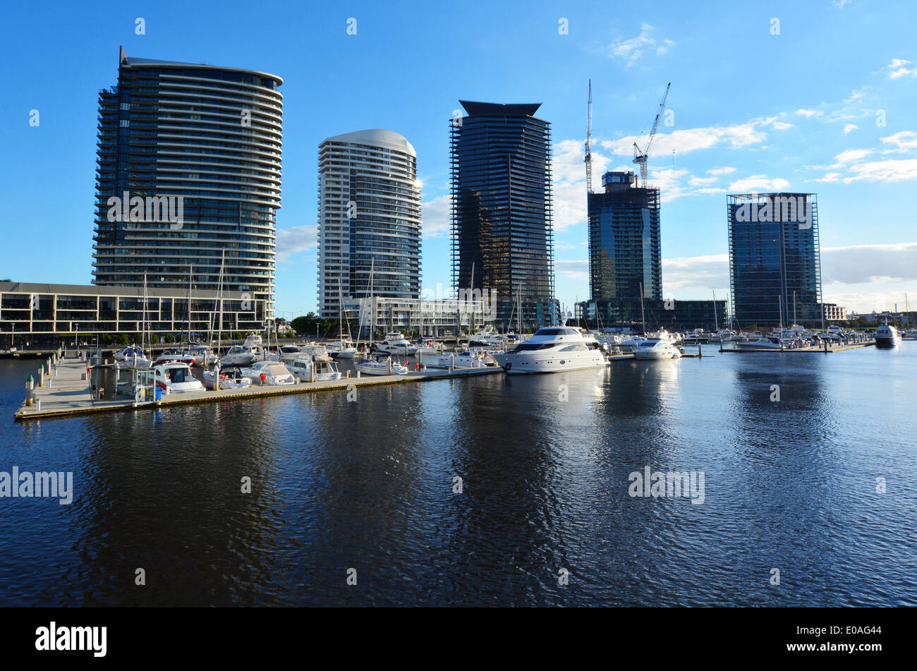 New buildings rises above the Yarra river in Docklands Melbourne Victoria Australia. - Stock Image