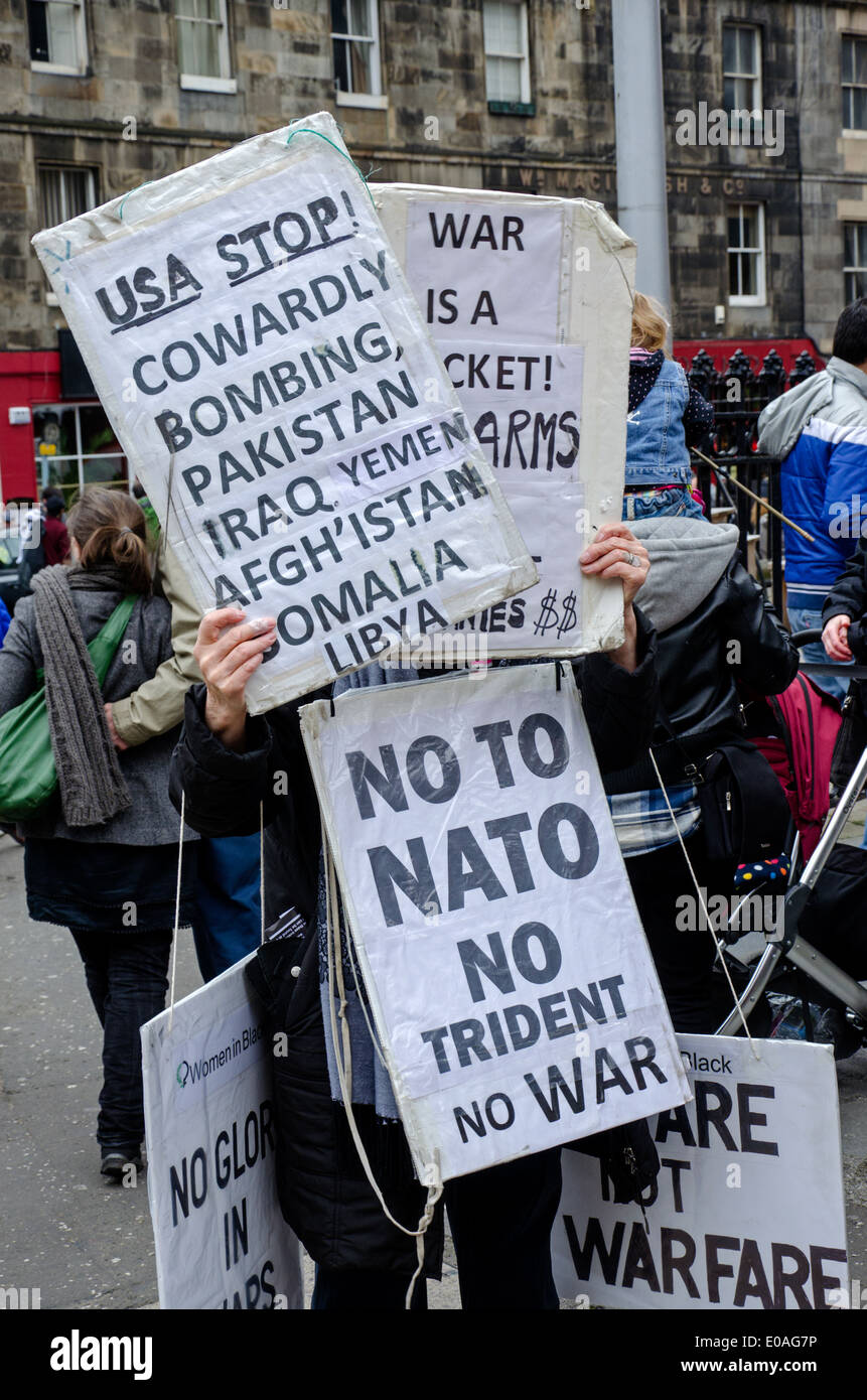 A demonstrator is almost completely hidden by signs at a May day Rally in Edinburgh, Scotland, UK. - Stock Image
